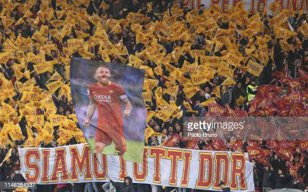 Roma fans hold a banner for the last match of Daniele De Rossi during the Serie A match between AS Roma and Parma Calcio at Stadio Olimpico on May 26...