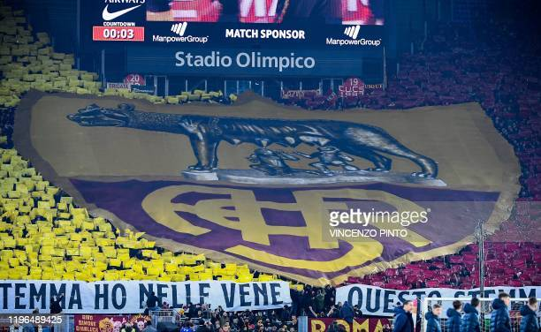 AS Roma fans unfurl a giant tifo prior to the Italian Serie A football match Roma vs Lazio on January 26 2020 at the Olympic stadium in Rome