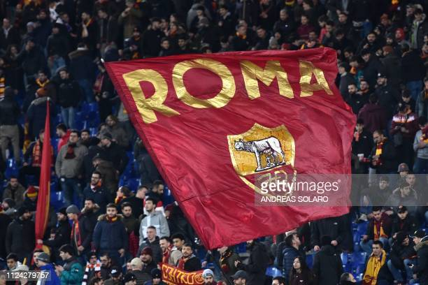 AS Roma fans wave a huge flag as they cheer prior to the UEFA Champions League round of 16 first leg football match AS Roma vs FC Porto on February...