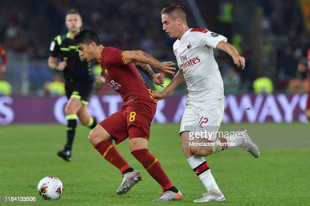Roma football player Diego Perotti and Milan football player Andrea Conti during the match RomaMilan in the Olimpic stadium Rome October 28th 2019