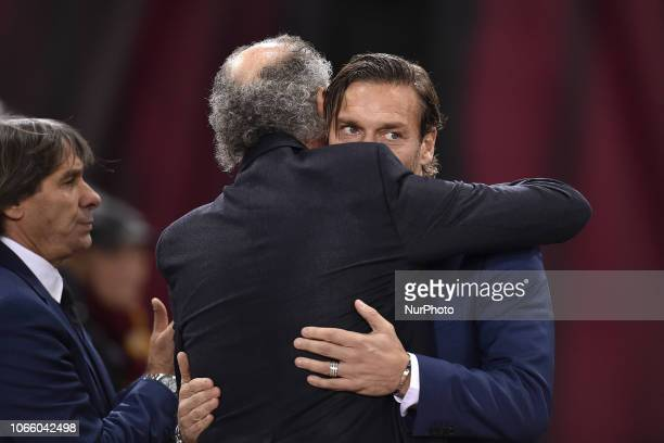 AS Roma former player Francesco Totti hugs AS Roma former player Paulo Roberto Falcao before the UEFA Champions League match between Roma and Real...