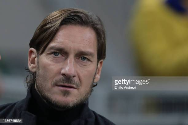 Roma former player Francesco Totti looks on prior to the Serie A match between FC Internazionale and AS Roma at Stadio Giuseppe Meazza on December 6,...