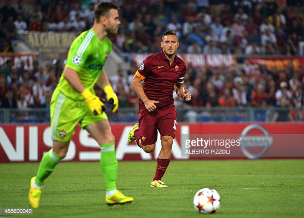 AS Roma forward and captain Francesco Totti fights for the ball with Moscow's goalkeeper Igor Akinfeev during the Champions League group E football...
