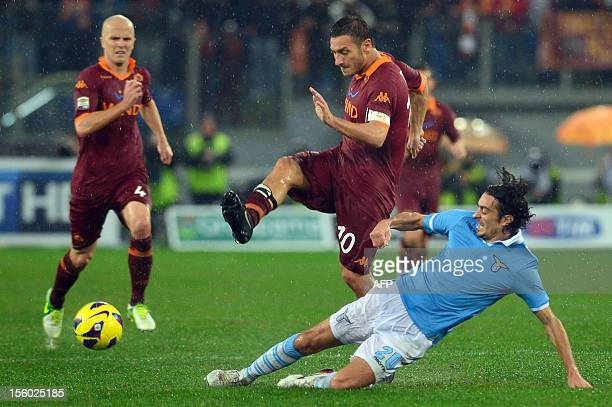 Roma forward Francesco Totti fights for the ball with Lazio's defender Giuseppe Biava during the Italian Serie A football derby between Lazio Rome...