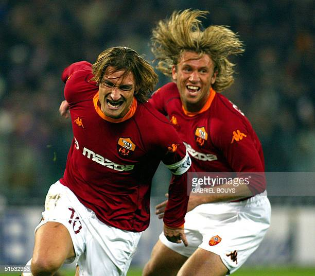 Roma forward Francesco Totti is congratuled by his teammate Antonio Cassano after he scored a goal during the Italian first league match AS Roma...