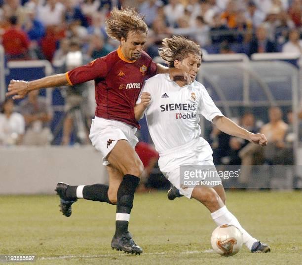 AS Roma forward Gabriel Batistuta battles against Real Madrid defender Michel Salgado at the Meadowlands in New Jersey 08 August 2002 The European...