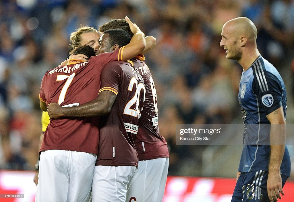 Roma forward Junior Tallo (20) is congratulated after scoring in the second half as MLS All-Stars defender Aurelien Collin, right, walks past the celebration on Wednesday, July 31, 2013, at Sporting Park in Kansas City, Kansas. Roma won, 3-1.