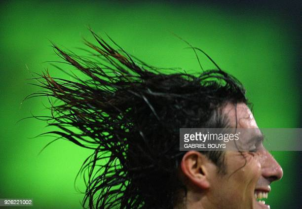 AS Roma forward Marco Delvecchio celebrates after scoring a goal during the Champions' League Group C first round match AS Roma AEK Athens 12...