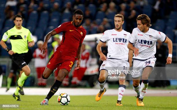 Roma Gerson left is challenged by Crotone Andrea Barberis center and Stefan Simic during the Serie A soccer match between Roma and Crotone at the...