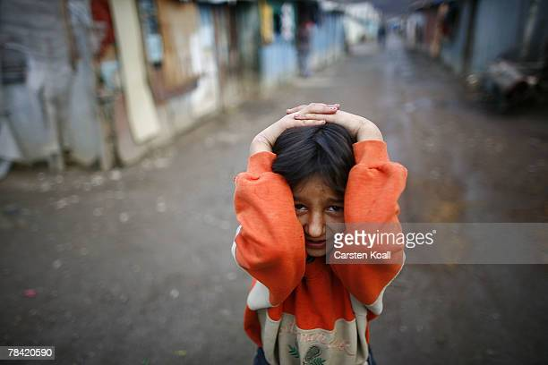 Roma girl covers up in the Cesmin Lug refugee camp in the Serbian district December 12 2007 in Kosovo province Serbia One hundred and fourtyfour...