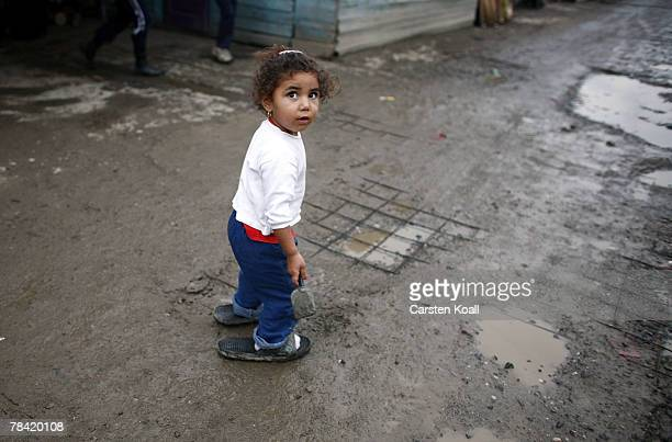 Roma girl plays in the mud in the Cesmin Lug refugee camp in the Serbian district December 11 2007 in Kosovo province Serbia One hundred and...