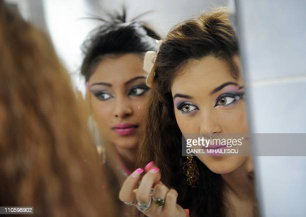 Roma girls apply the finishing touches to their makeup prior to the rehersal for Miss Piranda 2011 a Roma beauty contest Bucharest March 22 2011 Miss...
