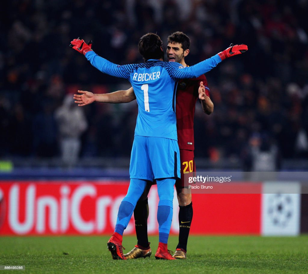 AS Roma goalkeeper Alisson Becker and Federico Fazio celebrate the victory after the UEFA Champions League group C match between AS Roma and Qarabag FK at Stadio Olimpico on December 5, 2017 in Rome, Italy.