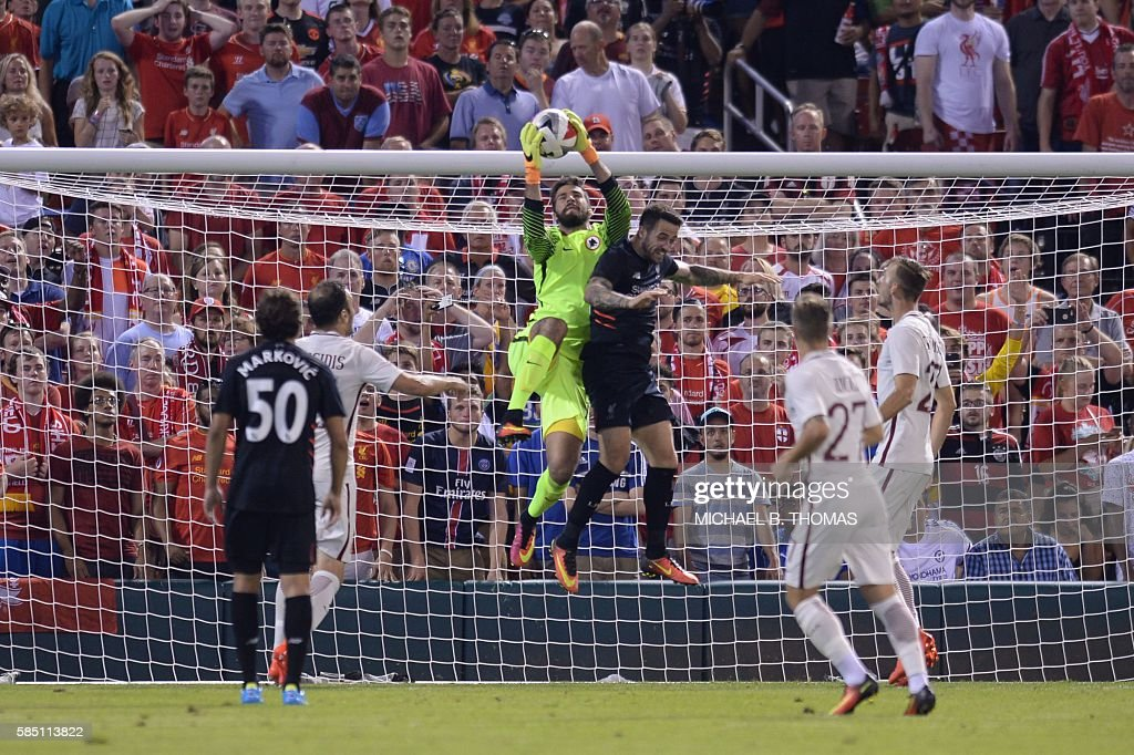 Roma goalkeeper Alisson Becker (19) makes a save against Liverpool during their friendly soccer match at Busch Stadium in St. Louis, Missouri on August 1, 2016. / AFP / Michael B. Thomas