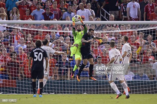 Roma goalkeeper Alisson Becker makes a save against Liverpool during their friendly soccer match at Busch Stadium in St Louis Missouri on August 1...