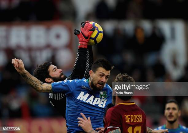 Roma goalkeeper Alisson competes for the ball with Francesco Acerbi of US Sassuolo during the serie A match between AS Roma and US Sassuolo at Stadio...