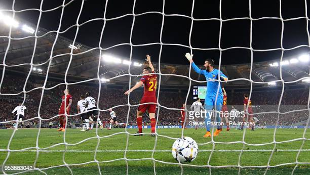 AS Roma goalkeeper Ramses Alisson reacts as Liverpool's Georginio Wijnaldum celebrates scoring his side's second goal of the game during the UEFA...