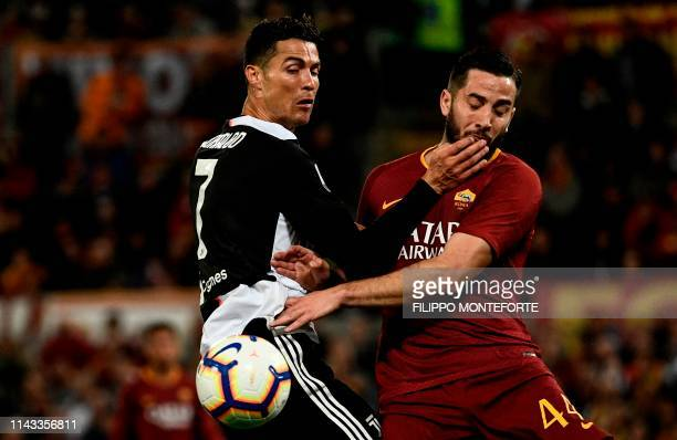 AS Roma Greek defender Konstantinos Manolas fights for the ball with Juventus' Portuguese forward Cristiano Ronaldo during the Italian Serie A...