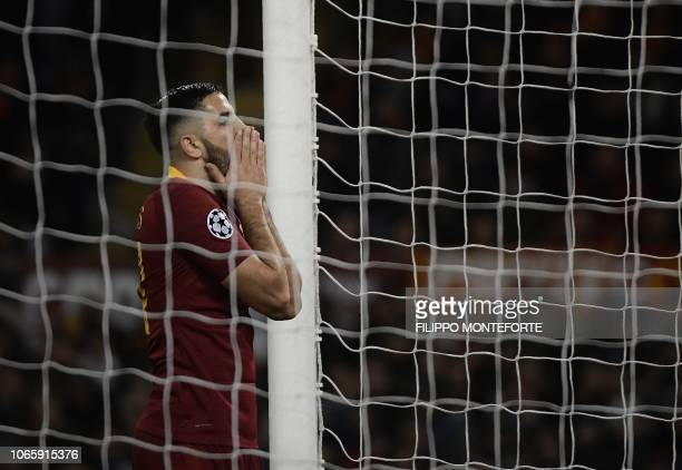 AS Roma Greek defender Konstantinos Manolas reacts after missing a goal during the UEFA Champions League group G football match AS Rome vs Real...