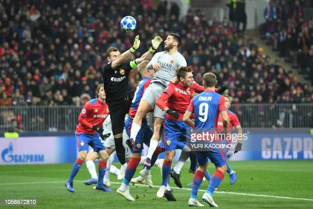 AS Roma Greek defender Konstantinos Manolas scores the opening goal past CSKA Moscow's Russian goalkeeper Igor Akinfeev during the UEFA Champions...