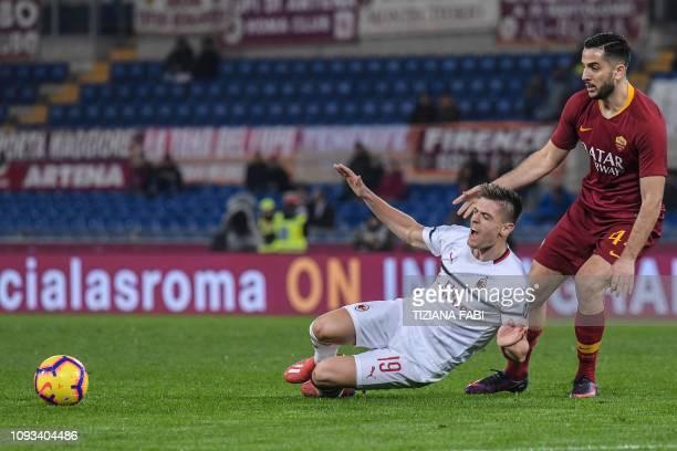 AS Roma Greek defender Konstantinos Manolas tackles AC Milan's Polish forward Krzysztof Piatek during the Italian Serie A football match AS Roma vs...