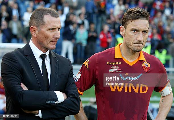 Roma head coach Aurelio Andreazzoli and Francesco Totti react after losing the Tim cup final against SS Lazio at Stadio Olimpico on May 26, 2013 in...