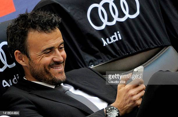 Roma head coach Luis Enrique looks at his mobile phone before the Serie A match between AC Milan and AS Roma at Stadio Giuseppe Meazza on March 24,...