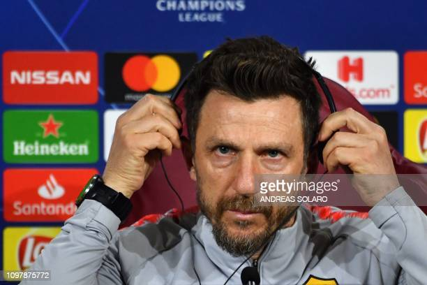 AS Roma Italian coach Eusebio Di Francesco adjusts a helmet to listen to a translation during a press conference on February 11 2019 at AS Roma's...