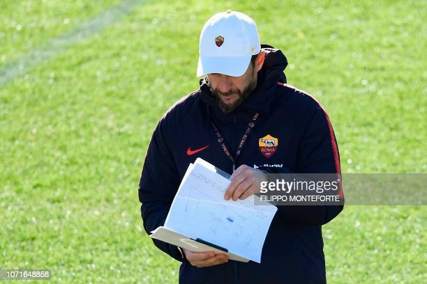 AS Roma Italian coach Eusebio Di Francesco checks his notes during a training session on the eve of the UEFA Champions League group G football match...