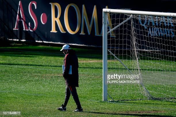 AS Roma Italian coach Eusebio Di Francesco walks across the pitch during a training session on the eve of the UEFA Champions League group G football...
