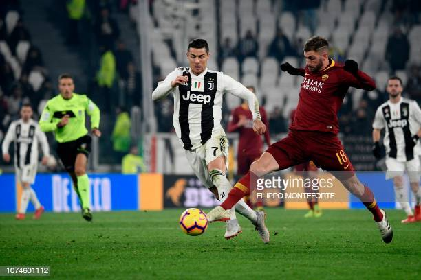 AS Roma Italian defender Davide Santon tackles Juventus' Portuguese forward Cristiano Ronaldo during the Italian Serie A Football match Juventus FC...