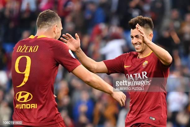 AS Roma Italian forward Stephan El Shaarawy celebrates with AS Roma Bosnian forward Edin Dzeko after scoring his second goal during the Italian Serie...