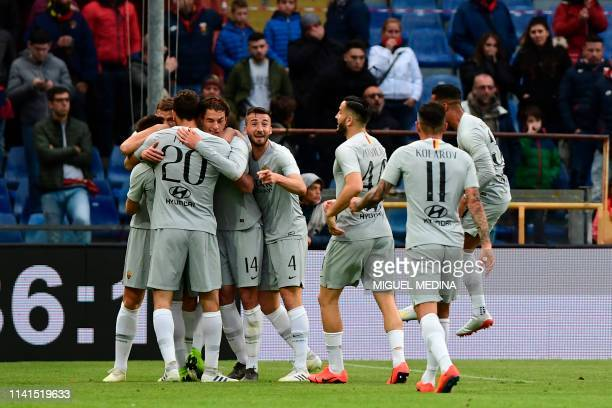 AS Roma Italian forward Stephan El Shaarawy is congratulated by teammates after scoring a goal during the Italian Serie A football match between...