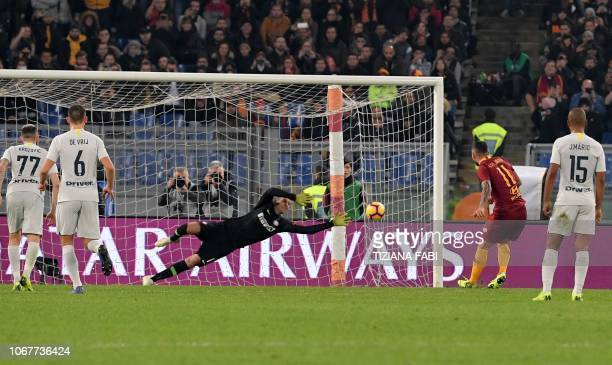 AS Roma Italian midfielder Aleksandar Kolarov scores a penalty during the Italian Serie A football match between AS Roma and Inter Milan at the...