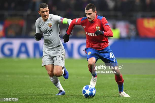 AS Roma Italian midfielder Alessandro Florenzi and CSKA Moscow's Russian defender Georgy Shchennikov vie for the ball during the UEFA Champions...