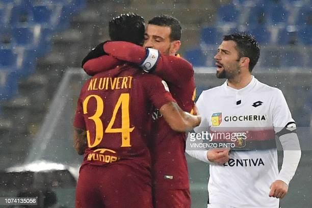AS Roma Italian midfielder Alessandro Florenzi embraces AS Roma Dutch forward Justin Kluivert after Kluivert scored an equalizer during the Italian...