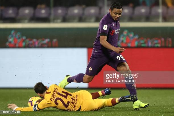 AS Roma Italian midfielder Alessandro Florenzi tackles Fiorentina's Colombian forward Luis Muriel during the Italian Tim Cup round of eight football...
