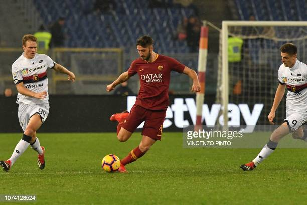 AS Roma Italian midfielder Bryan Cristante passes the ball under pressure from Genoa's Swedish midfielder Oscar Hiljemark and Genoa's Polish forward...