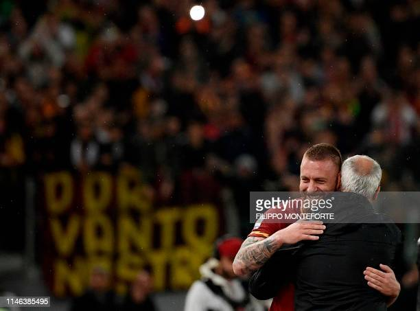 Roma Italian midfielder Daniele De Rossi is acknowledged by Roma coach Claudio Ranieri during Serie A football match Roma vs Parma on May 26 2019 at...