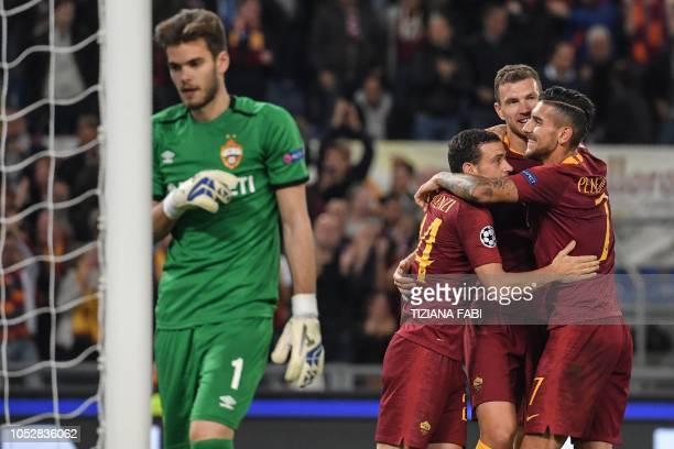 AS Roma Italian midfielder Lorenzo Pellegrini AS Roma Bosnian forward Edin Dzeko and AS Roma Italian midfielder Alessandro Florenzi celebrate after...