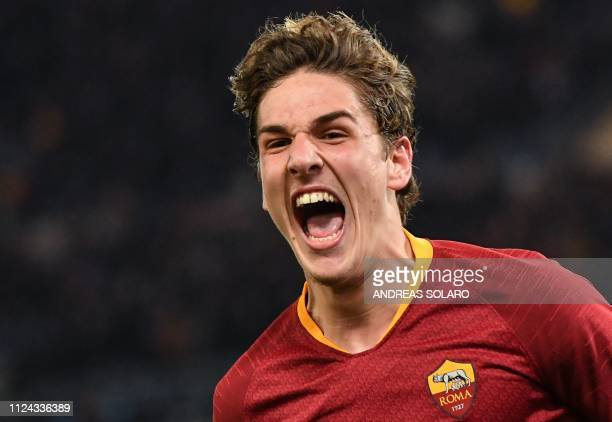 AS Roma Italian midfielder Nicolo Zaniolo celebrates after opening the scoring during the UEFA Champions League round of 16 first leg football match...