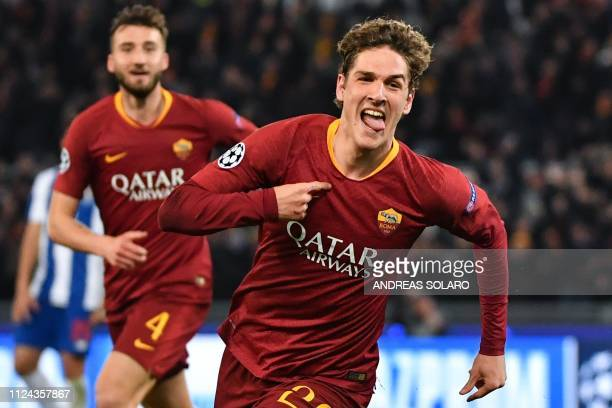 Roma Italian midfielder Nicolo Zaniolo celebrates after opening the scoring during the UEFA Champions League round of 16 first leg football match AS...