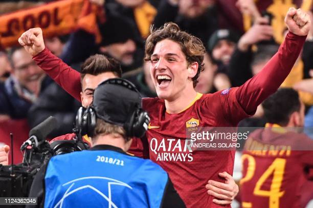 AS Roma Italian midfielder Nicolo Zaniolo celebrates after scoring his second goal during the UEFA Champions League round of 16 first leg football...