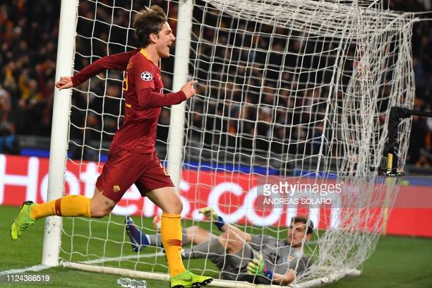 AS Roma Italian midfielder Nicolo Zaniolo celebrates after scoring past Porto's Spanish goalkeeper Iker Casillas during the UEFA Champions League...
