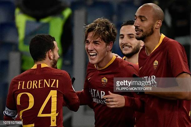 AS Roma Italian midfielder Nicolo Zaniolo celebrates with AS Roma Italian midfielder Alessandro Florenzi and AS Roma French midfielder Steven Nzonzi...