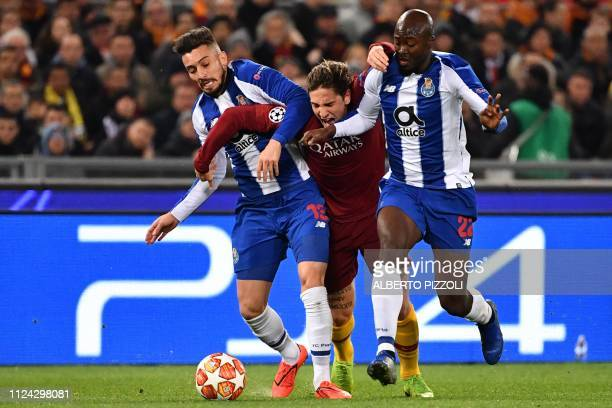 AS Roma Italian midfielder Nicolo Zaniolo gets squashed between Porto's Brazilian defender Alex Telles and Porto's Portuguese midfielder Danilo...