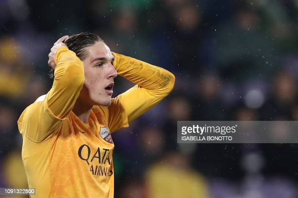 AS Roma Italian midfielder Nicolo Zaniolo reacts after missing a shot during the Italian Tim Cup round of eight football match Fiorentina vs AS Roma...