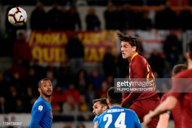 AS Roma Italian midfielder Nicolo Zaniolo shoots a header to score an equalizer during the Italian Serie A football match AS Roma vs Fiorentina on...