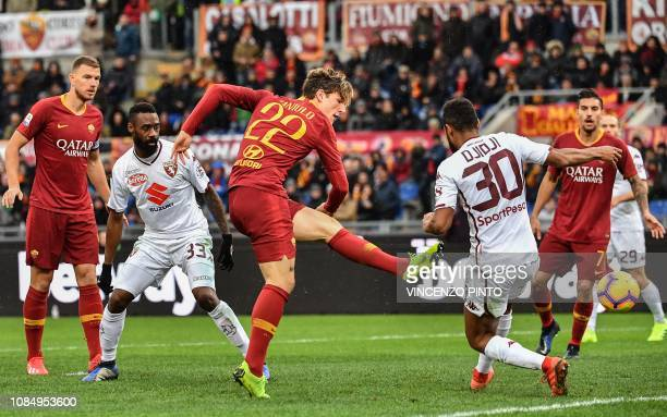AS Roma Italian midfielder Nicolo Zaniolo shoots on goal despite Torino's French defender Koffi Djidji during the Italian Serie A football match AS...
