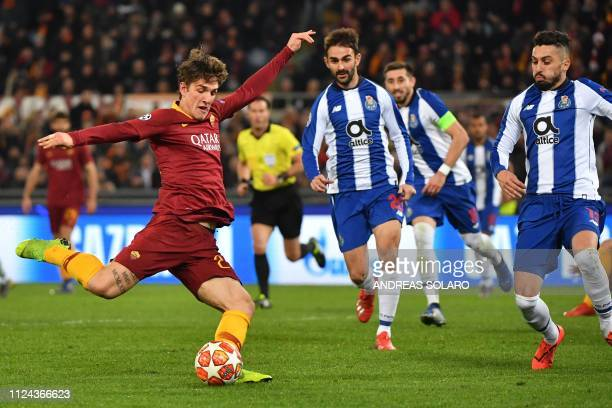 AS Roma Italian midfielder Nicolo Zaniolo shoots to open the scoring during the UEFA Champions League round of 16 first leg football match AS Roma vs...